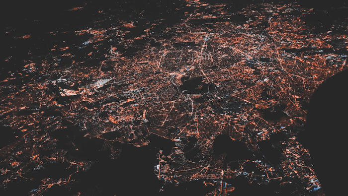 A satellite photo of electricity use above a city. Used under Unsplash License.