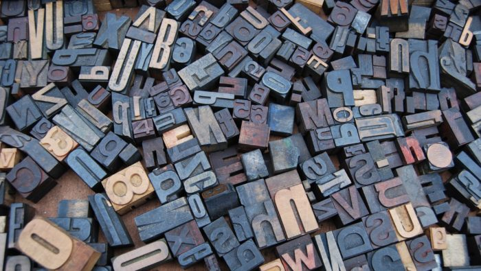 A photo of wooden letters cut out