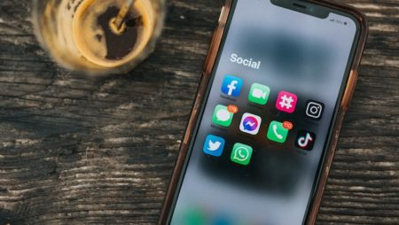 Photo of phone with social media apps by Nathan Dumlao